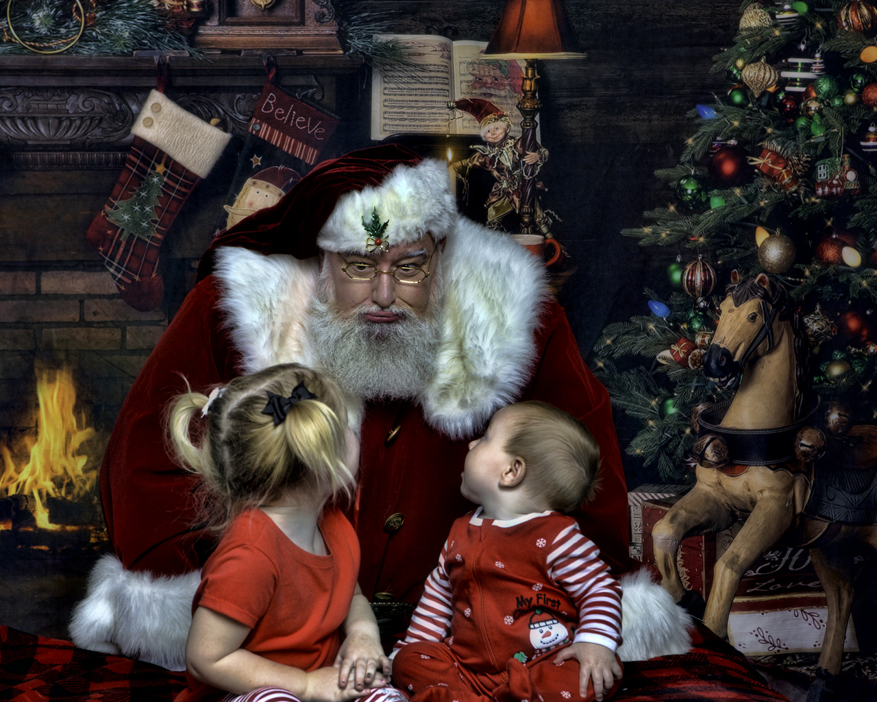 Santa talking to two little babies