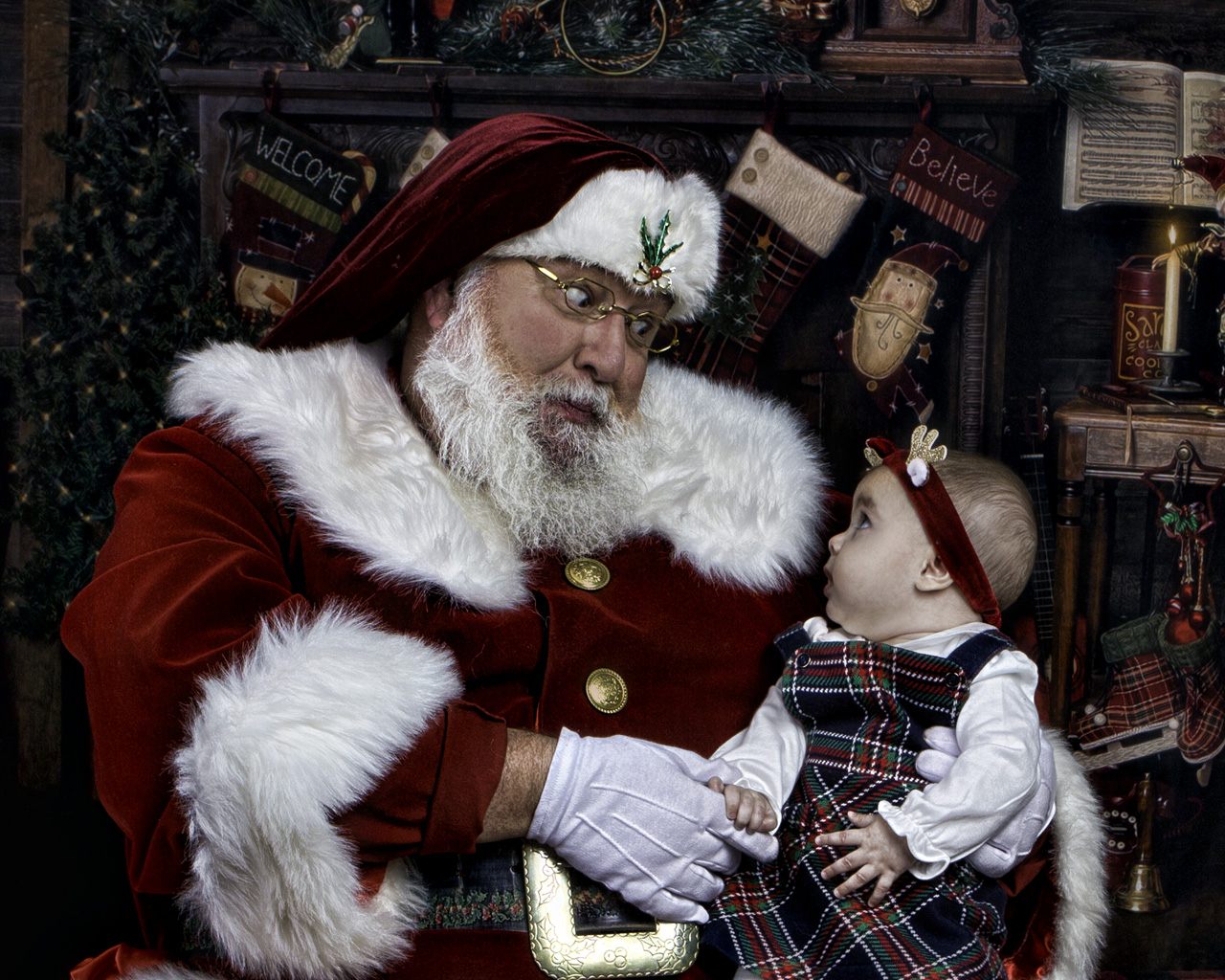 Santa entertaining a baby